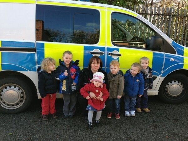 PC Gemma Greaves with youngsters from Messy Monkeys