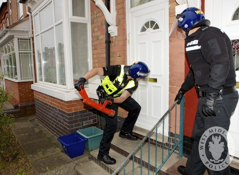 Officers force their way into a property as Operation Intrusive warrants were enforced | Photo WMPolice
