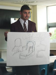 King's-Heath-Boys'-Mathematics-&-Computing-College-pupil-Abid-presents-the-Curve-pregnancy-chair-in-the-'Dragon's-Den'-style-challenge.