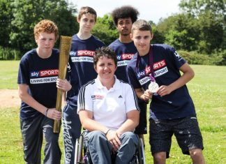 Paralympics star Mel Clarke with students from ARK Kings Academy