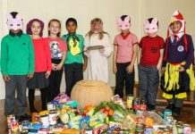 ARK Rose Primary Academy Harvest Celebration with pupils from a play and foodbank collection