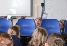 Year 2 pupils from ARK Rose Primary Academy use puppets to tell the story of Diwali
