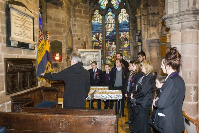 ARK Rose and ARK Kings pupils are given a tour of St Nicolas' Church war memorial