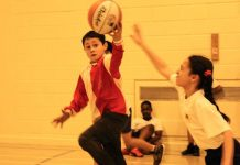 Primary school players compete at the Birmingham School Games basketball tournament at ARK Kings Academy