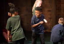 2 pupils from ARK Rose Primary Academy take part in a stage fight as part of the RSC 'The Head that Wears a Crown' performnce