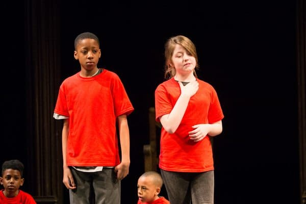 3 pupils from ARK Rose Primary Academy taking part in the RSC production of 'The Head that Wears a Crown'