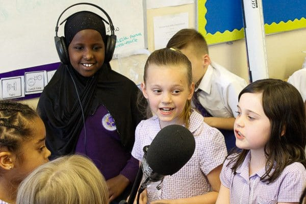 Pupils from Ark Rose Primary Academy record a pop song as part of Confidence Day 2015