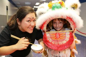 Li-an Yeng of Redditch Chinese Association and Rhiannon Rhodes, aged 8