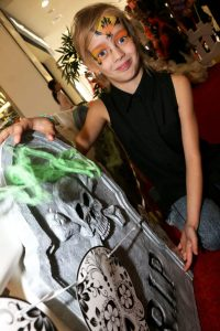 Eight-year-old Katie Pitt gets ready to be transformed in the Haunted House photo booth