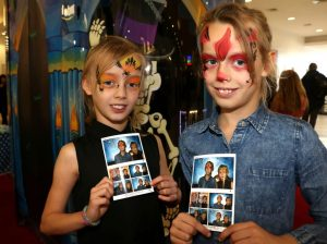 Katie Pitt, aged eight (left) and Sophie-Lee Pitt, nine, with pictures from Haunted House photo booth.
