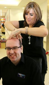 Student Claire Barley Sam Richards gives Steven Cardwell a head massage