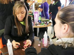 Student Sarah Whitehead gives a manicure to Kerry Grannell from Quinton