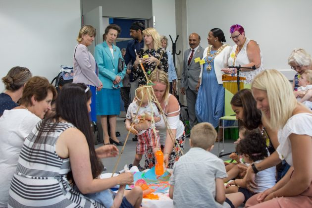 HRH The Princess Royal oversees a family session at the new TouchBase Pears centre