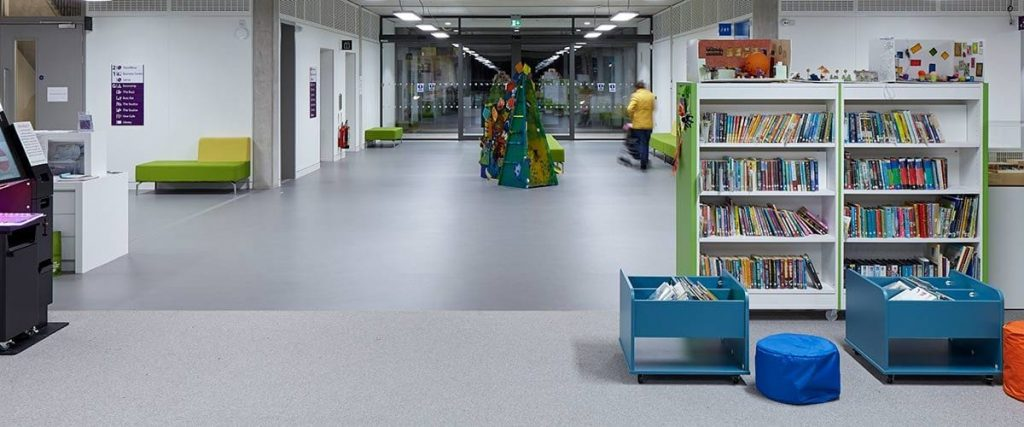 Some of the accessible spaces and facilities at TouchBase Pears - an inside space with lots of room, children's library books shelves, seating areas, electric glass doors