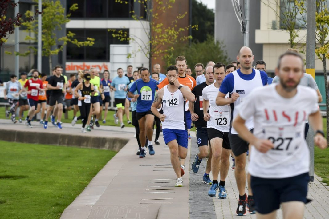 Runners at the LandAid 10k in 2018 running around Austin Park in Longbridge